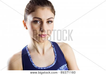 Fit brunette looking at camera on white background