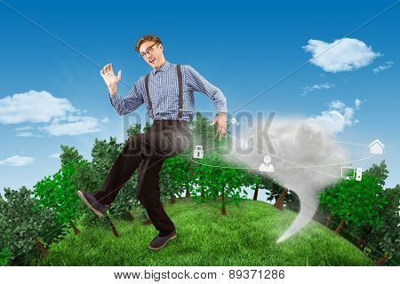 Geeky hipster walking and looking at camera against cloud computing graphic with icons