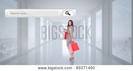 Elegant brown hair posing with shopping bags against bright white hall with columns