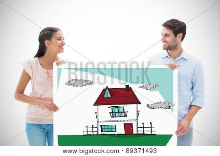 Attractive young couple smiling and holding poster against white background with vignette