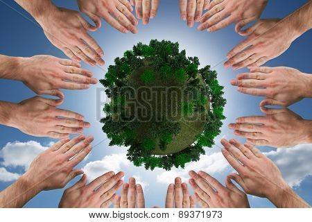 Circle of hands against cloudy sky with sunshine
