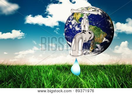 Earth with faucet against green field under blue sky