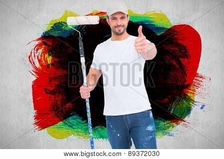 Handyman holding paint roller against white and grey background