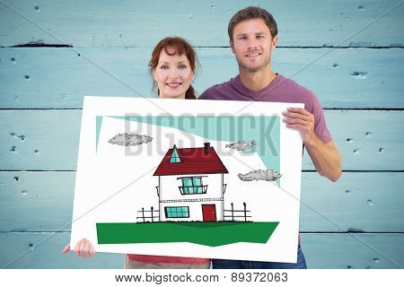 Couple holding a white sign against painted blue wooden planks