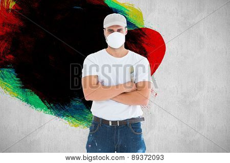 Man with paintbrush standing arms crossed by ladder against white and grey background