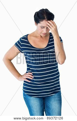 Sad woman holding her head on white background