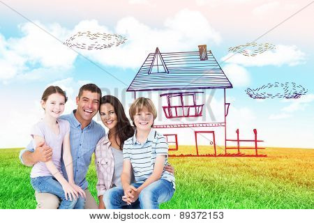 Happy children sitting on parents laps against blue sky over green field