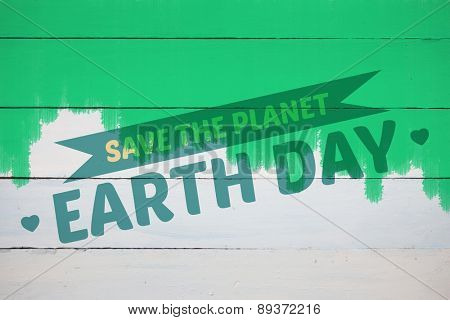 save the planet against green paint on fence