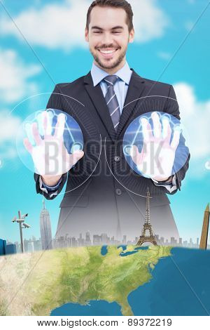 Happy businessman presenting his hands against blue sky