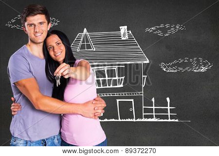 Young couple showing keys to house against black wall