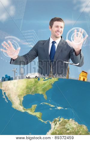 Smiling businessman with hands up against shiny cityscape on black background