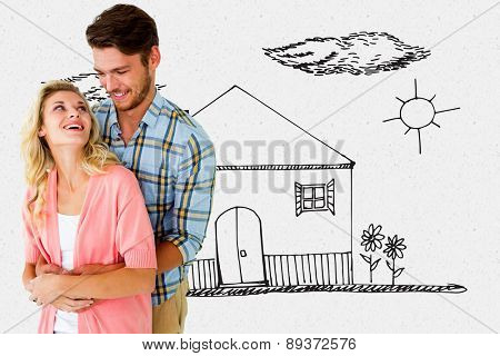 Attractive young couple embracing and smiling against grey