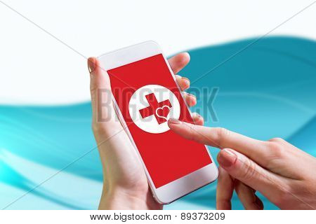 Hand holding smartphone against futuristic blue and white background
