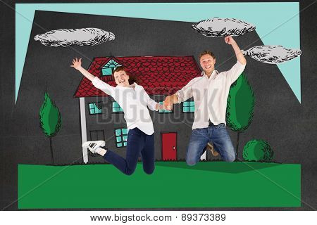 Couple jumping and holding hands against black wall