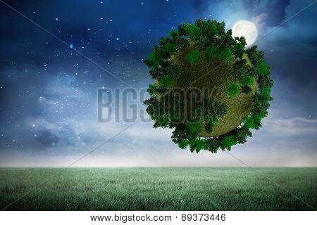 Sphere covered with forest against night sky