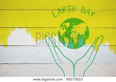 Earth Day Graphic against yellow paint on fence