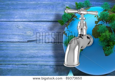 Earth with faucet against wooden background
