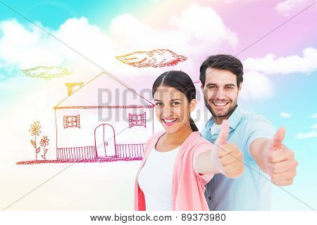 Happy couple showing thumbs up against blue sky
