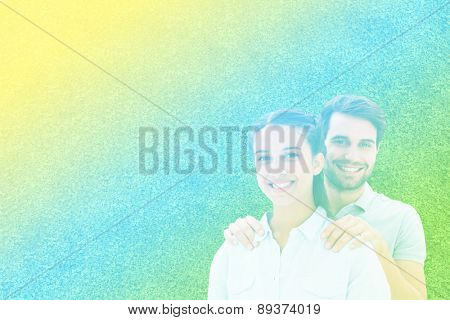 Cute couple smiling at camera against astro turf surface