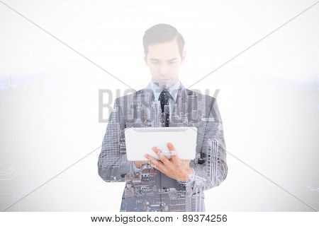 Businessman holding a tablet computer against high angle view of city