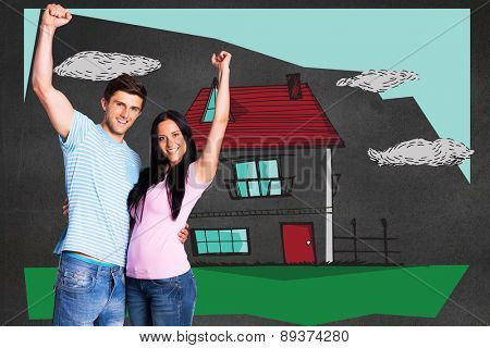 Young couple cheering at camera against black wall