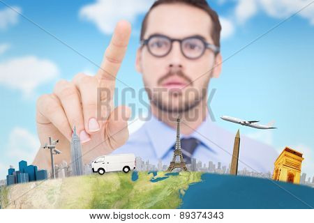 Businessman with glasses pointing something against blue sky