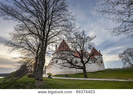 Bauska castle restored part during sunset time. HDR image