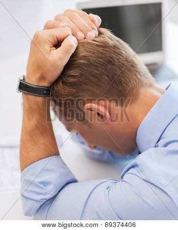 business, office and health concept - stressed businessman at work