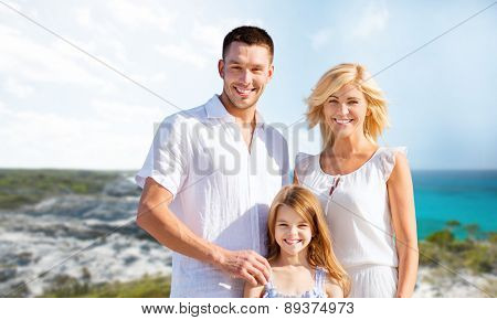 holidays, travel, tourism and people concept - happy family over summer beach background