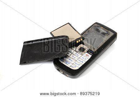 Old Damaged Mobile Phone Isolated On White Background