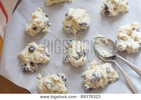 Preparing blueberry drop biscuits