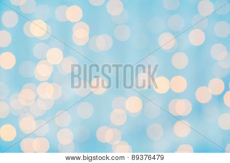 holidays, party and celebration concept - blurred blue and golden background with bokeh lights