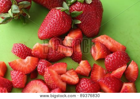 Chopped fresh strawberries on cutting board