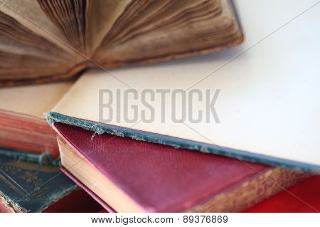 Old books, two open with copy space