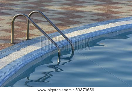 Close Up Of A Ladder In A Swimming Pool