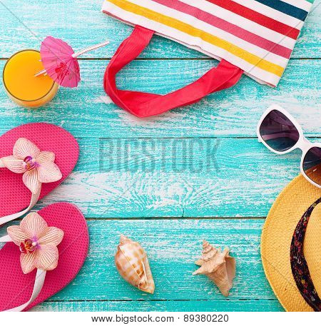 Summer Holidays. Beachwear on wooden background.