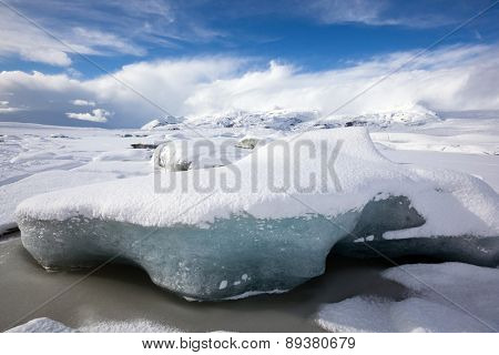 scenic snow covered mountains and glaciers of the Fjallsarlon Glacier in Iceland.