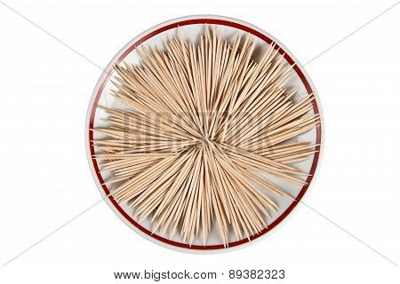 Wooden toothpicks arranged on a plate