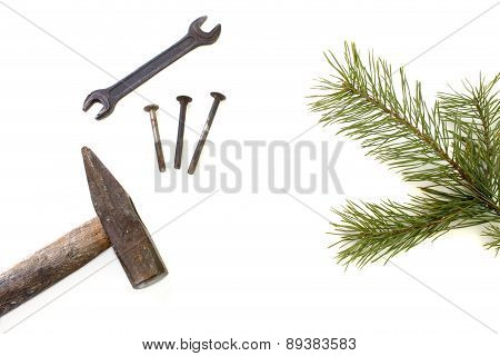Hammer And Pine Branch Isolated Over White
