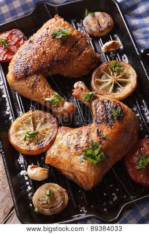 Chicken Legs And Vegetables On The Grill Pan Vertical Top View