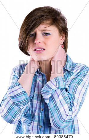 Pretty brunette with neck pain looking at camera on white background