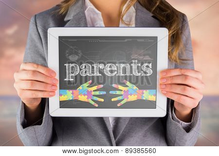 The word parents and businesswoman showing a tablet pc against medical biology interface in black