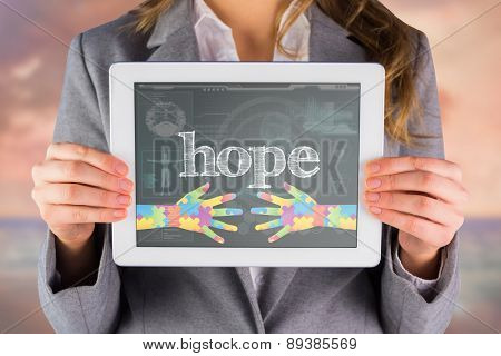 The word hope and businesswoman showing a tablet pc against medical biology interface in blue