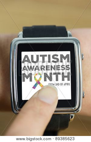 Businesswoman with smart watch on wrist against autism awareness month