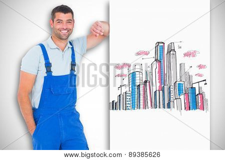 Happy repairman leaning on blank placard against white background with vignette
