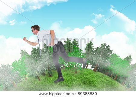 Geeky businessman running late against blue sky