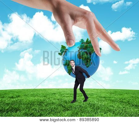 Hand showing against field and sky