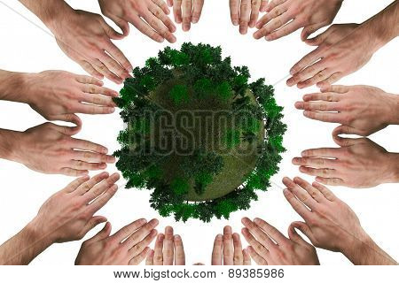 Circle of hands against sphere covered with forest