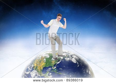 Geeky hipster dancing and smiling against white clouds under blue sky