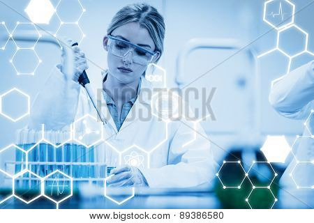 Science graphic against science student using pipette in the lab